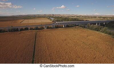 Descending over corn field with railway bridge - Flying over...