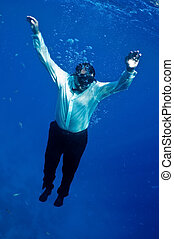 descends into depths - man in black trousers, white shirt,...
