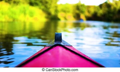 Descent on the river on kayaks among green thicket, view...