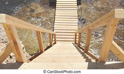 Descent to the sea on a wooden staircase, top view