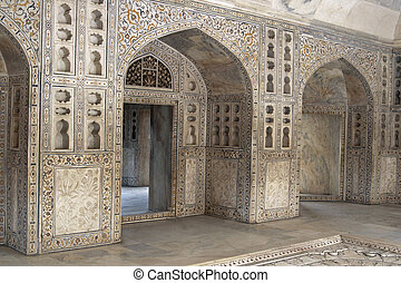 Description:Detail of richly carved marble walls and arches decorating a Mughal Palace inside the Red Fort, Agra