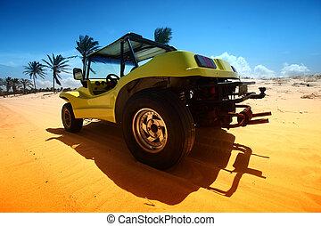 desert buggy in desert sand under blue sky