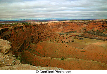 Canyon de Chelly, land sacred to the modern Navajo nation as it was to the ancient Anasazi, shown at sunset with a storm coming in.