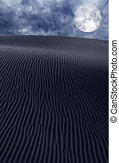 Desert dunes sand in moon night sky