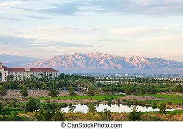 Desert Golf Resort with Purple Mountains in Distance