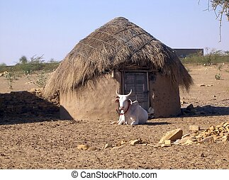 desert hut - a straw hut in the middle of the desert