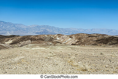 desert landscape in death valley national park under blue...