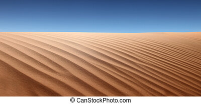 Panoramic view of desert landscape. No one is viewable in the shot. Horizontally framed shot.