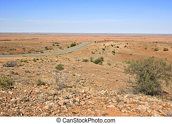 road through the beautiful but hot dry and barren desert in australian outback