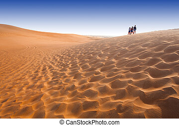 desert landscape with people in background.