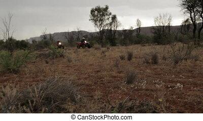 Desert motor ridding, Australia Outback - Wide evening pan...