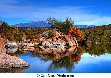 Desert Pond - Arizona desert pond, rocks, and mountains
