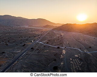 Desert road at sunset aerial view