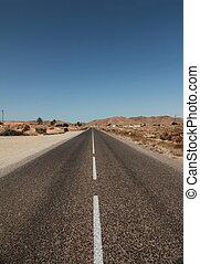 lonely desert highway the sahara desert, north africa