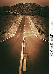 Desert Road To Nowhere. Vertical Dark Sepia Color Grading...