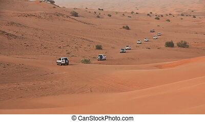 Desert Safari SUVs bashing through the arabian sand dunes 4...