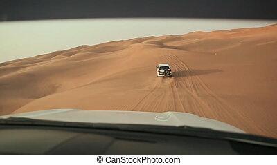 Desert Safari SUVs bashing through the arabian sand dunes....