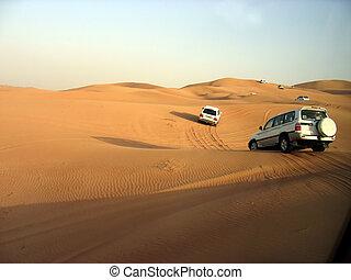 SUVs Trek Across the Desert Dunes