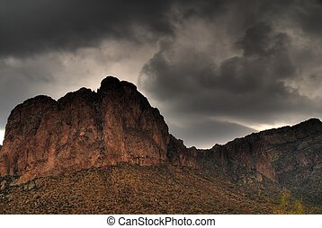 Desert Storm Approaching 6 - Dramatic desert mountains with...