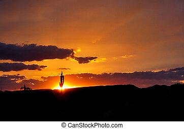 A beautiful Arizona sunset with saguaros cactus silhouette and cloud