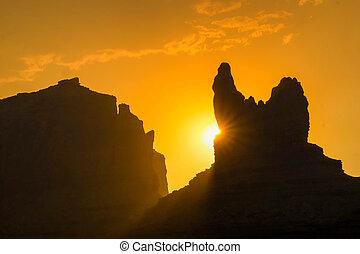 desert sunset over a rock butte