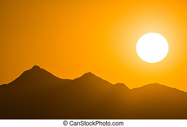 desert sunset with a mountain silhouette