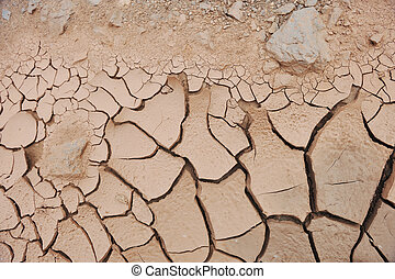 Large geometric cracked earth pattern. Desert dry lake bed.