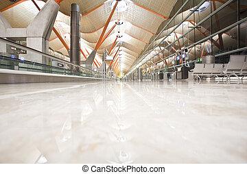Deserted airport terminal, high key.