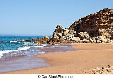 deserted beach on the Atlantic coast near Cadiz, Spain.