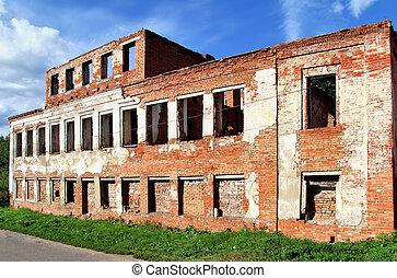 Deserted brick building over a blue sky