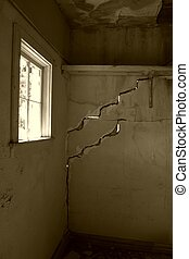 Cracked walls and stained walls of a deserted building