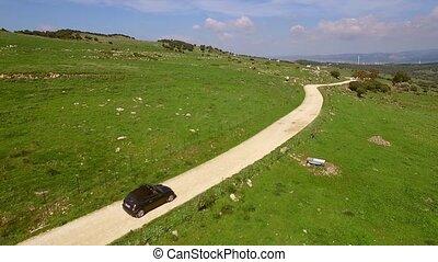 Deserted long gravel road through the country - Deserted...