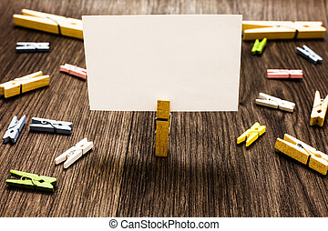 Design business concept Empty copy space modern abstract background Clothespin holding white paper note several clothespins wooden floor