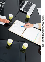 Design drawing review - Hands of business people pointing at...