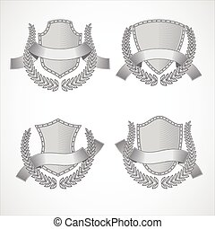 Design elements. Vector set of shields with Laurel wreaths and ribbons. Style of engraving