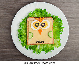 design food. Creative sandwich for a child with a picture little owl