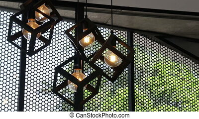 Design hanging light bulbs in coffee shop, stock footage