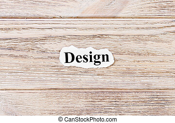 Design of the word on paper. concept. Words of Design on a wooden background