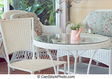 design of vintage style interior in cafe with flowers vase on white furniture