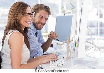 Design team working on computer