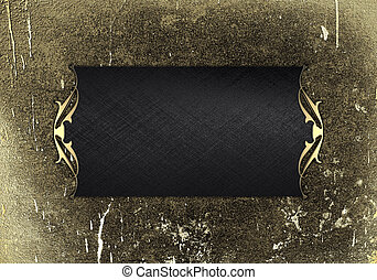 Grunge wall with black plate and a beautiful gold trim -...