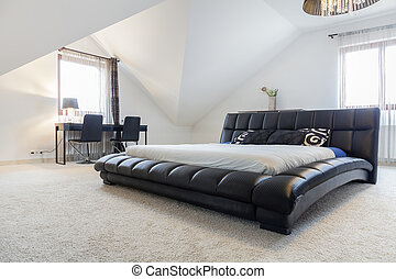 Designed bed in modern bedroom