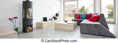 Designed living room with colorful pillows, panorama