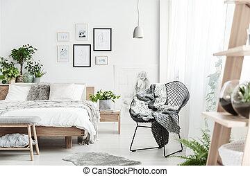 Designer chair in natural bedroom