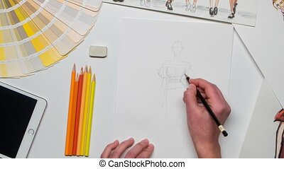 Designer creates a sketch using paints for the magazine. Close up. Time lapse
