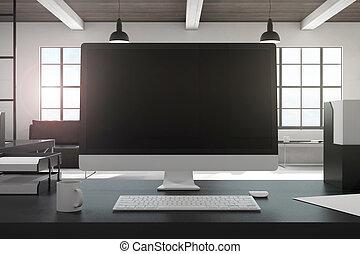 Designer desktop with black computer