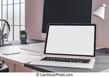 Designer desktop with white laptop