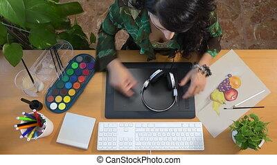 Designer drawing listening music graphic tablet art still life creativity