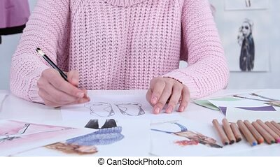Designer dress hands create beautiful drawings with pencils...