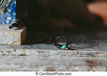 designer glasses. brown frame and transparent glass